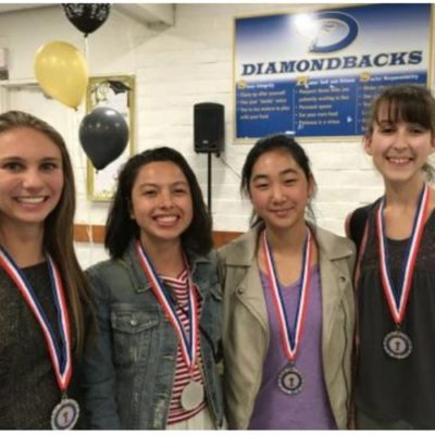 Teenage girls with winner medals over the necks