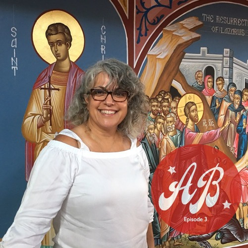 Woman in front of christian mural