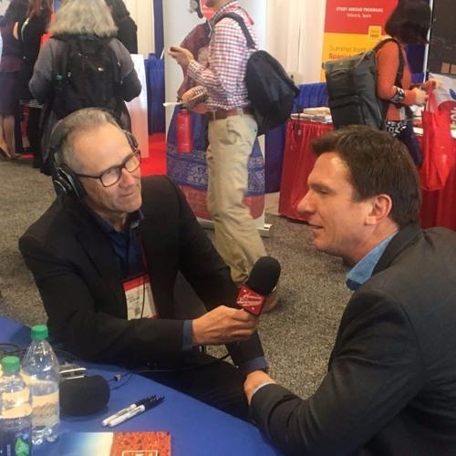 Steve Leveen interviewing Bill Weir, mike in hand